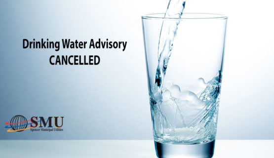 glass with water going in and text: Drinking Water Advisory Cancelled
